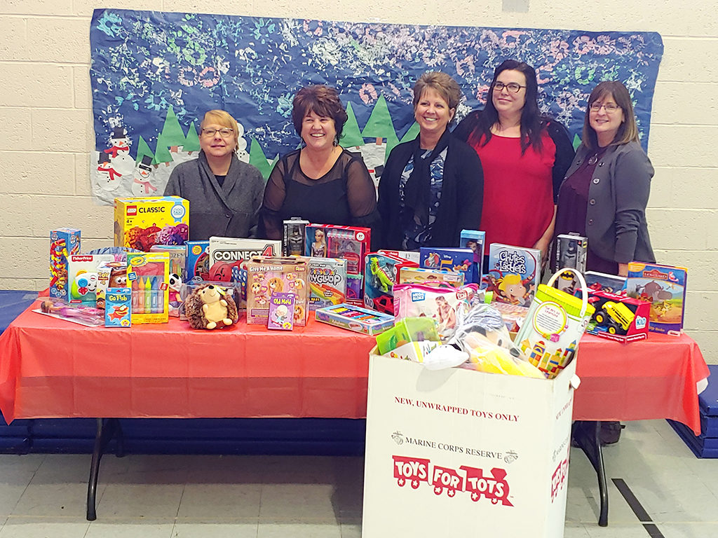 staff donating toys for toys for tots.